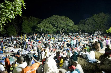 Displaced Haitians gather on Place Boyer in Petion-Ville to spend the night.