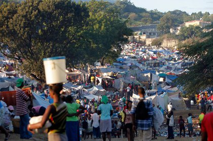 People crowd at a makeshift camp for earthquake survivors set up on a golf course in Port-au-Prince.