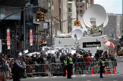 Media trucks and crowds