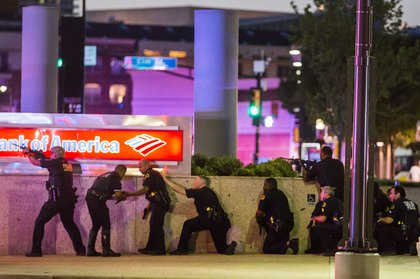 Dallas Police respond after shots were fired at a Black Lives Matter rally in downtown Dallas (Smiley N. Pool/The Dallas Morning News via AP)