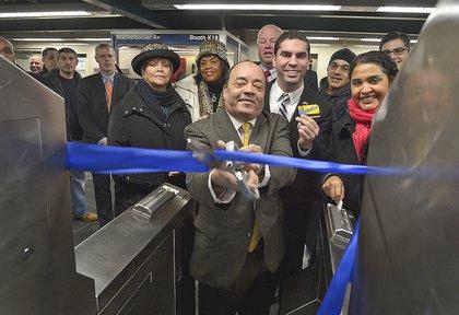 State Senator Martin Dilan cuts the ribbon at the Knickerbocker M station yesterday morning.