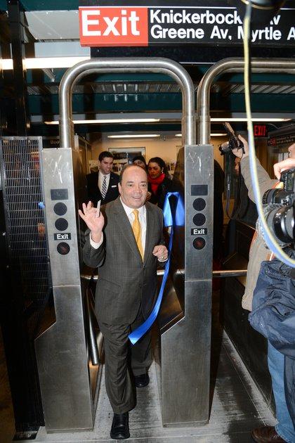 State Senator Martin Dilan is the first to pass through the turnstiles.