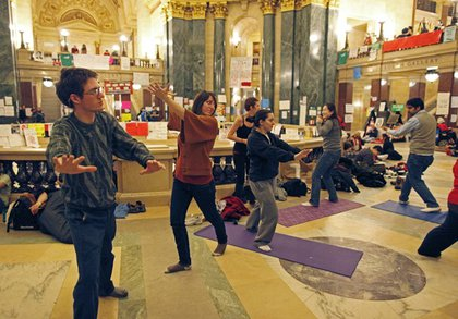 Protesters do yoga inside the state Capitol in Wisconsin this morning.