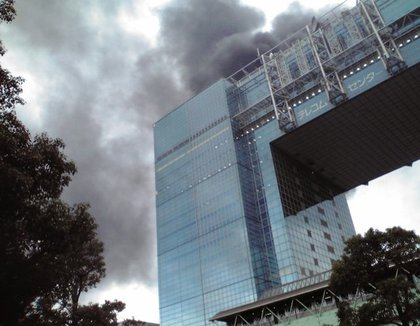 Black smoke rises from a burning building in Tokyo's Odaiba area in Tokyo Bay area after Japan was struck by a magnitude 8.9 earthquake off its northeastern coast Friday, March 11, 2011.