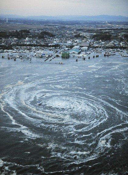 Tsunami swirls near a port in Oarai, Ibaraki Prefecture (state) after Japan was struck by a strong earthquake off its northeastern coast Friday, March 11, 2011.