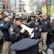 Police order protesters to disperse.