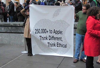 Demonstrators outside the 5th Avenue Apple store  .