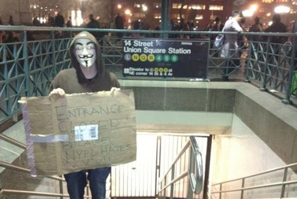 """The sign says """"Entrance closed because NYPD hates you."""""""