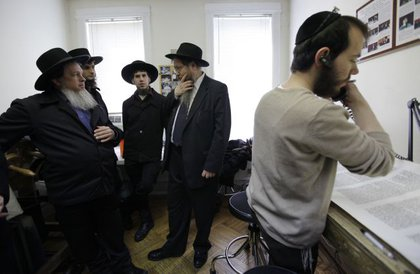 Rabbi Beryl Epstein, second from right, explains the intricacies of a scribe's work.