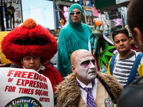 Costumed characters protesting an earlier version of King's licensing bill in September 2014