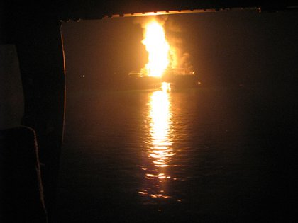 In this Wednesday April 21, 2010 photo released by the U.S. Coast Guard, a fire aboard the mobile offshore drilling unit Deepwater Horizon burns 52-miles southeast of Venice, La.