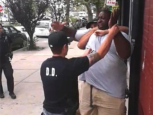 Video taken of the arrest that preceded Eric Garner's death shows what one top NYPD official described as a chokehold during testimony on Tuesday.
