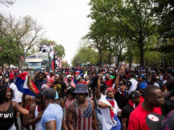 Revelers with Haitian flags at the West Indian Day Parade on Eastern Parkway last September. More than 20,000 Haitians in NYC benefit from TPS, according to 1199SEIU.