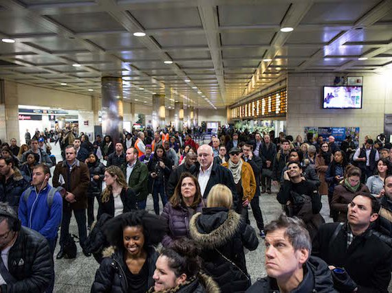 Are these commuters looking up for help from a god who doesn't exist, or staring at the LIRR departure board for updates?