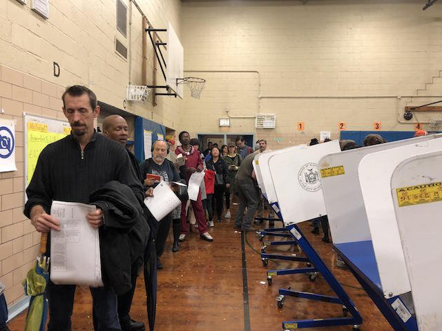 Voters waited in line to scan their ballots at a polling site in Clinton Hill Brooklyn on Election Day in 2018.