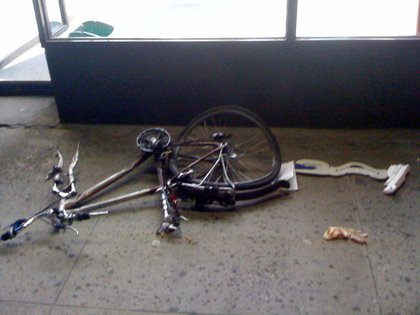 """Delivery guy's bike and bloody glove after the crash."""