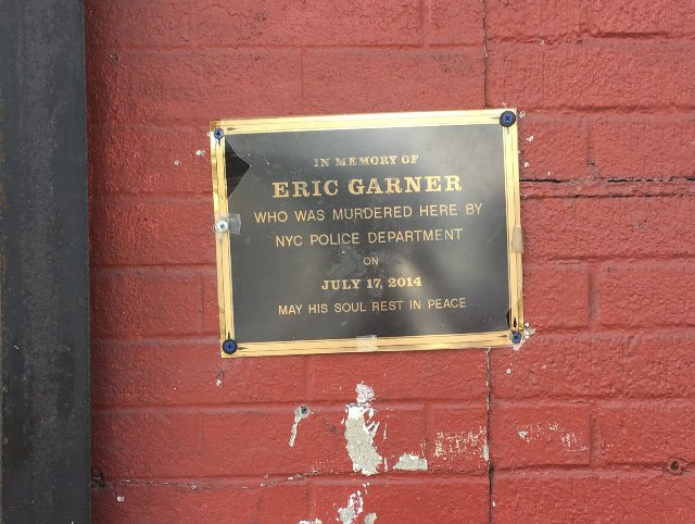 A makeshift plaque marks the spot where Eric Garner was brought to the ground by Officer Daniel Pantaleo.