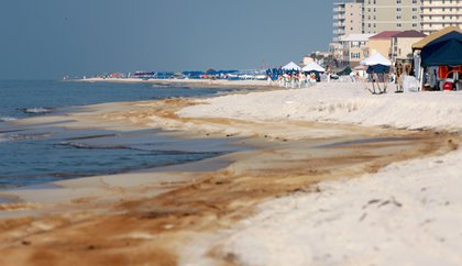 Cleanup crews work to remove oil form the Deepwater Horizon oil spill in Orange Beach, Ala.
