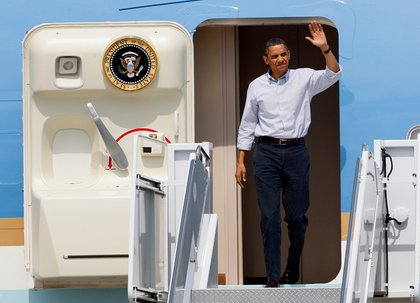 President Barack Obama waves as he walks off of Air Force One at Gulfport-Biloxi International Airport in Gulfport, Miss. today.