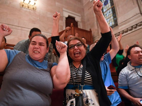 Spectators celebrate after legislation sponsoring the Green Light Bill granting undocumented Immigrant driver's licenses was passed by the Senate during a Senate session at the state Capitol, in Albany, N.Y