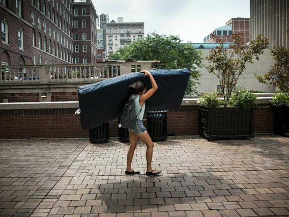 Emma Sulkowicz carries a mattress around Columbia's campus in 2014