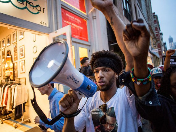 Delrawn Small's newphew Zayanahla Vines, 22, leads a march of protesters through Manhattan six days after Small was shot and killed by off-duty NYPD officer Wayne Isaacs.