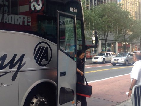 Marina from Melville disembarks her personal charter bus on Wednesday morning