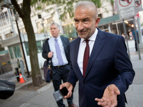 Alain Kaloyeros, foreground, leaves federal court in New York.