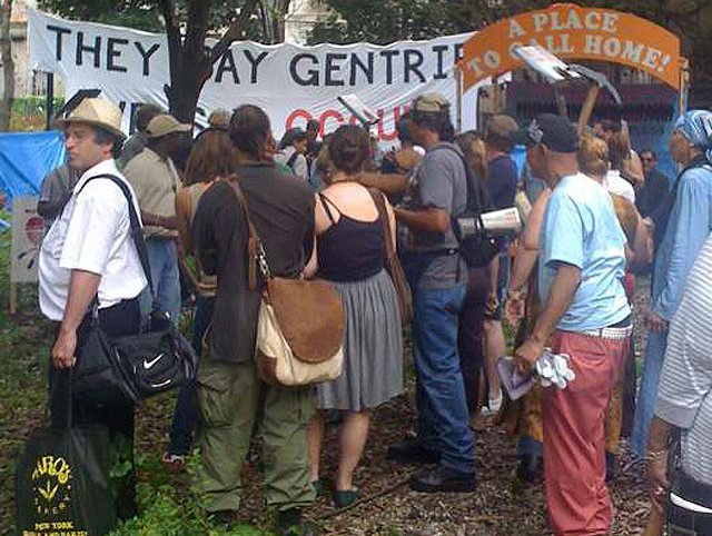 """The banner reads, """"THEY SAY GENTRIFY, WE SAY OCCUPY."""" Courtesy Picture the Homeless"""
