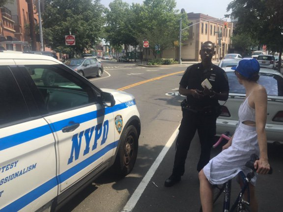 A cyclist is issued a ticket in Greenpoint this week.