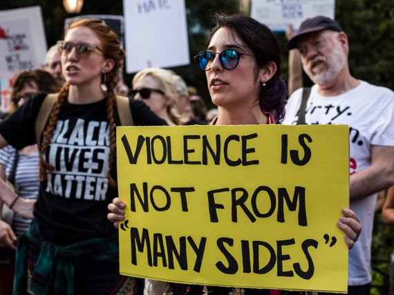 """New Yorkers gathered in Union Square Sunday to hold a vigil for victims of racist violence at the Charlottesville """"Unite the Right"""" rally."""