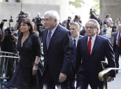 Dominique Strauss-Kahn, his wife Anne Sinclair, and his defense team enter the courthouse.