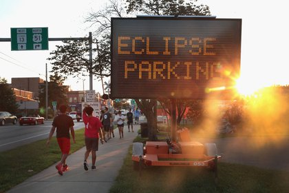 A sign directs visitors to parking areas to view the solar eclipse on August 19, 2017 in Carbondale, Illinois. With approximately 2 minutes 40 seconds of totality the area in Southern Illinois will experience the longest duration of totality during the eclipse. <br>