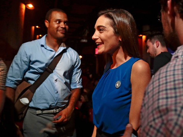 Julia Salazar, right, talks with supporters after winning the Democratic primary over Martin Dilan in New York's 18th State Senate district race.