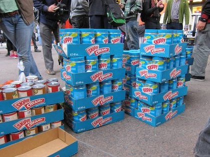 """Lots of people carried sleeping bags and guys werepassing out jars of peanut butter (donated by Food Not Bombs) for""""when people start to get hungry."""""""