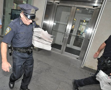 Police confiscate fake copies of the New York Post outside News Corp. headquarters.