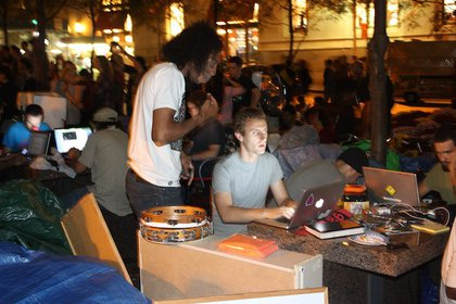 Zuccotti Park's makeshift media center is powered by a generator and battery power swiped from McDonalds