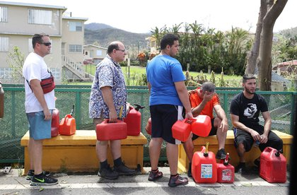 People wait in line for gas as electrical, water, and gas grids remain damaged after in Aibonito, Puerto Rico. (Joe Raedle/Getty Images)