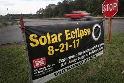 A sign placed by the Army Corps of Engineers urges people to view the solar eclipse from the Barkley Dam Powerplant on August 17, 2017 in Kuttawa, Kentucky. The dam is located along the path of totality in Western Kentucky.<br>