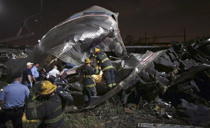 First responders look at the wreckage (AP)