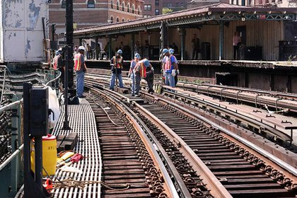 """Track Workers prepare to remove and install new track rail fasteners at Dyckamn St (1)."""