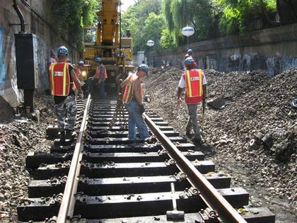"""Track Workers put finishing touches on installation of new track section outside Newkirk Ave (Q)."""