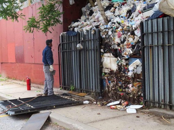 This undated photo shows a six-ton trash pile in Brownsville that accumulated over the course of 30 years before its removal in 2014.