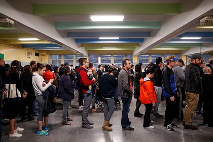 People wait in line to vote at a polling site at Public School 261 (Getty Images)