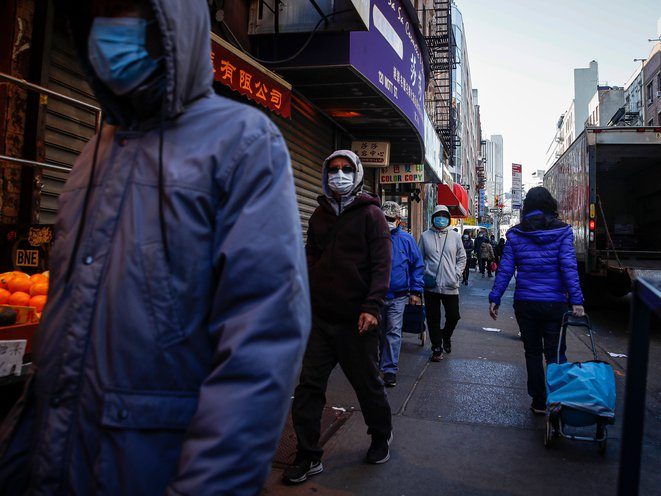 Pedestrians wear face masks in Chinatown on March 16th.