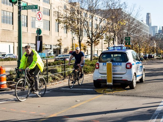 Cyclists on the West Side Greenway two days after a driver careened down it, killing eight people and injuring twelve more.