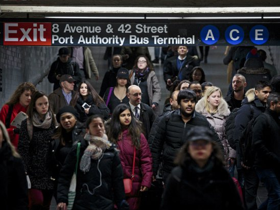 People walk through a passageway in the subway station under the Port Authority Bus Terminal where Akayed Ullah detonated a pipe bomb strapped to his body last year