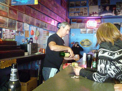 """Owner Michael Sarrel pours himself a shot of Jameson. When his daughter Cara reminded him of the no-drinking-behind-the-bar rule, he replied, """"Yeah, I broke my own rules. I'm allowed today."""""""