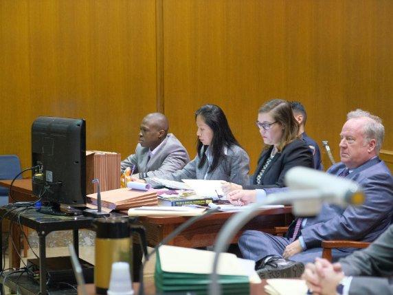 Chanel Lewis with his legal defense team last week