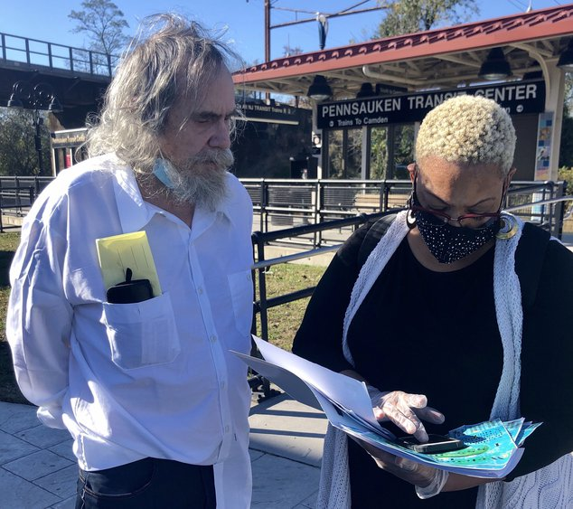 Volunteer Deborah Johnson assists Edmund Wells, who had nowhere to go after just being released from prison in New Jersey.